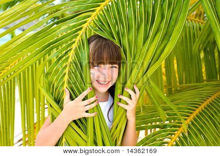 Girl and palm leaves