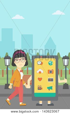 An asian young woman walking with a big smartphone. Woman and big smartphone in the park. Woman holding the hand of smartphone. Smartphone addiction. Vector flat design illustration. Vertical layout.