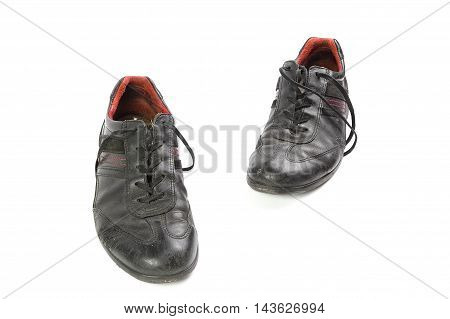 worn black men's shoes isolated on a white background