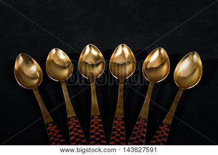 Vintage Golden Spoon On A Gray Background