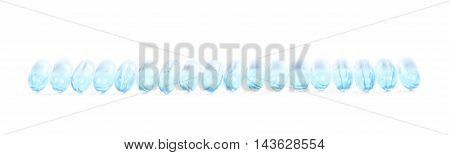 Line of multiple softgel pills isolated over the white background