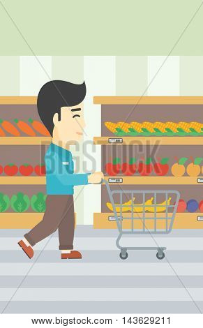 An asian young man pushing empty supermarket cart. Customer shopping at supermarket with cart. Man walking with trolley on aisle at supermarket. Vector flat design illustration. Vertical layout.