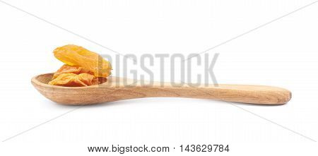 Spoon of dried apricots isolated over the white background