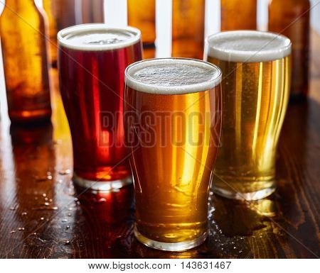 three types of beer, red ale, IPA, and stout