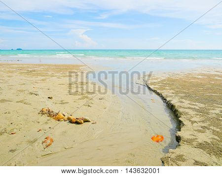 Small creek with water flows into the sea in Koh Chang Island Thailand