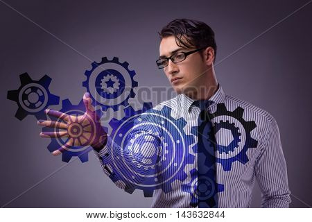 Businessman with cogwheels gear in teamwork concept