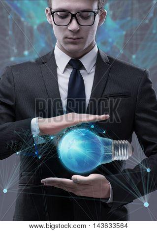 Young businessman in bright idea concept