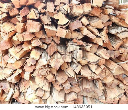 The Stack of chopped firewood on background