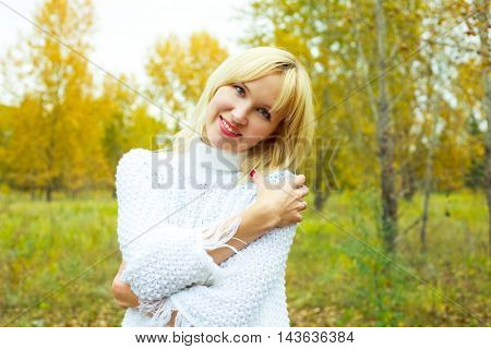 happy laughing blond woman in the autumn park