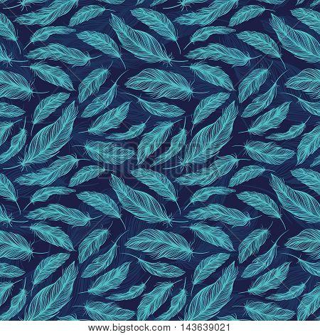 Seamless boho style texture with tribal turquoise feathers on indigo blue background