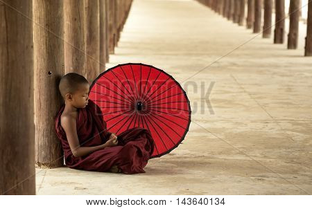 Little monk sleeping in the pagoda mandalayBurma