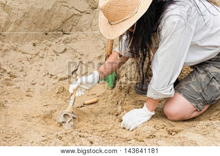 Archaeologist at work, side view, horizontal, toned image