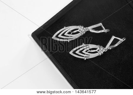 Diamond earrings in black jewel box closeup