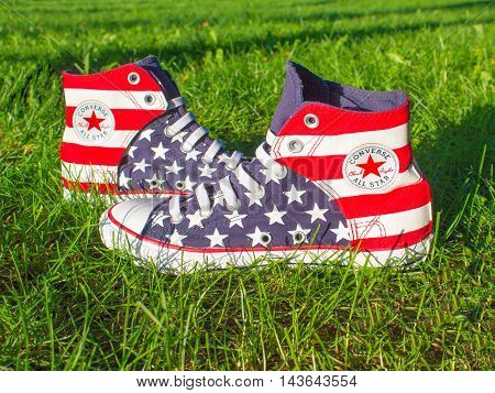 Dnipropetrovsk Ukraine - August 21 2016: All Star Converse sneakers on green grass in park