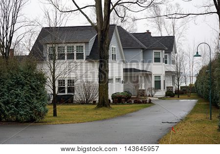 WEQUETONSING, MICHIGAN / UNITED STATES - DECEMBER 22, 2015: A large home with on Pennsylvania Avenue in Wequetonsing.
