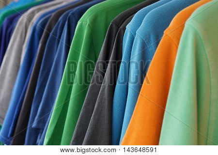 clothes rack with multicolored men's polo shirts