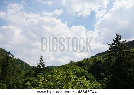Harz mountains in Germany, wooded foothills and cloudy sky