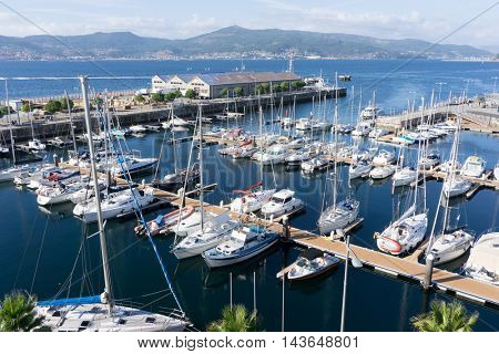 VIGO, SPAIN - AUGUST 17, 2016: The marina in Vigo, Spain. Vigo, which was first settled as a small fishing village, is ideally positioned and provides a safe, sheltered harbor.