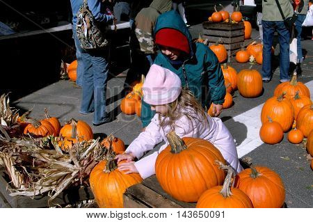 New York City - October 29 2006: Children choosing their Halloween pumpkin at the annual West 100th Street Fall Festival