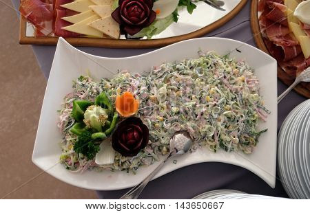 Classic Croatian plate with fine salad with ham