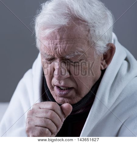 Coughing Man Covered With Blanket