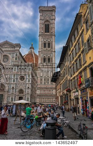 Florence, Italy - June 9, 2016: A crowd in The Piazza del Duomo located in the heart of the historic center of Florence. In the piazza is also the Santa Maria del Fiore Cathedral and Giotto's Bell Tower.