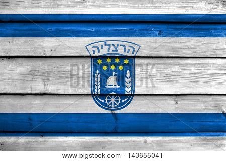 Flag Of Herzliya City , Israel, Painted On Old Wood Plank Background