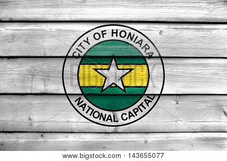 Flag Of Honiara, Solomon Islands, Painted On Old Wood Plank Background