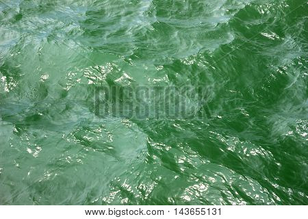 Texture turquoise sea water with sunny reflections