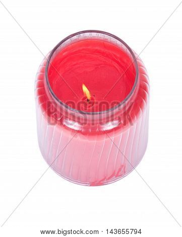Red candle in house warmer jar separated on white background