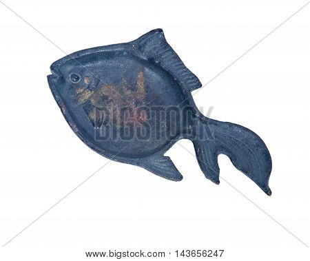 Cast iron fish decoration separated on white background