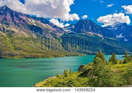 Montana Glacier Mountains. Glacier National Park Scenic Summer Landscape with Lake. Montana United States.