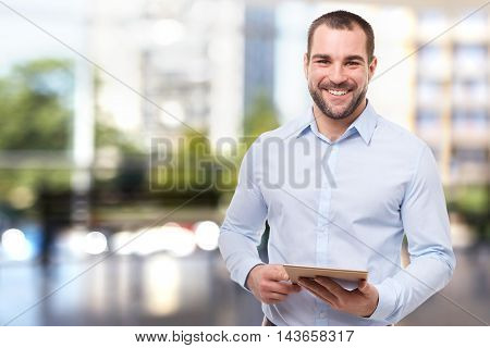 Portrait Of Professional Business Man In Office With Tablet Computer