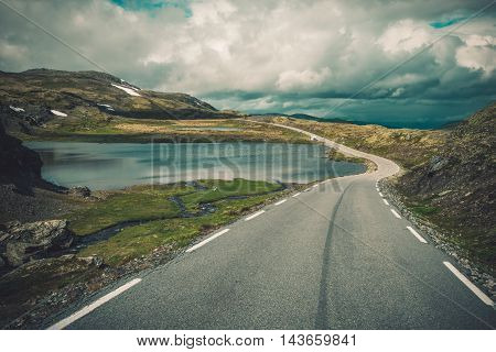 Scenic Norway Road Trip. Mountain Alpine Landscape and the Road. Norway Europe.