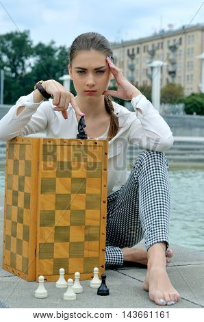 Woman Closed The Chessboard.