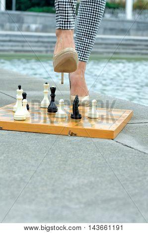Woman Sitting On An Open Chessboard.