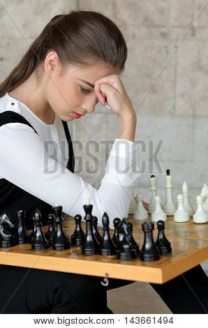 Girl Thought Before A Game Of Chess.
