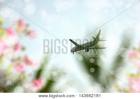 commercial airplane flying in sunny sky.