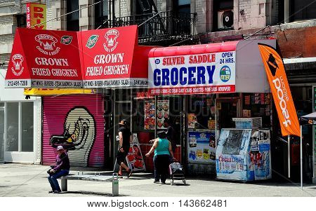 New York City - August 13 2014: Fast food and a small grocery store on Broadway in Harlem's Hamilton Heights neighborhood