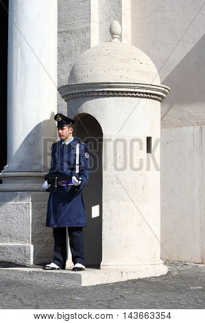 ROME - MARCH 1: Guard stands in the sentry box at Quirinale Palace on March 10 2012 in Rome Italy. At 12 noon of every day is possible to watch the changing of the guards ceremony