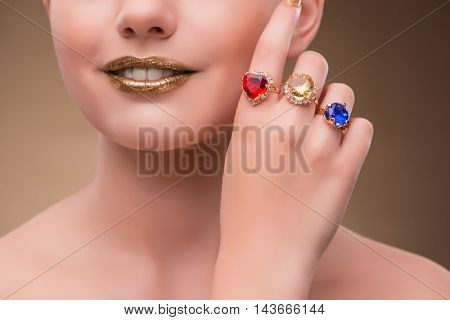 Elegant woman with jewellery in fashion concept