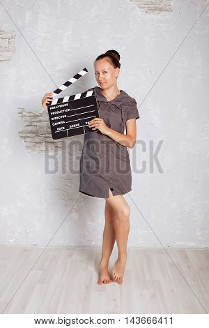 Girl Director announces takes. hand with a Film clapperboard.