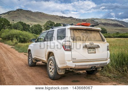 HOHNHOLZ LAKES STATE WILDERNESS AREA, CO, USA - AUGUST 19, 2016: Toyota 4Runner SUV (2016 Trail edition) on a dusty dirt road in Colorado's Rocky Mountains