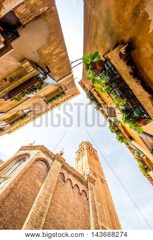 View from below on basilica dei Frari and houses in Venice