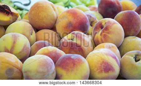 picture of a Fresh Organic Peaches Heap Of Fresh Ripe Peaches At A Market.
