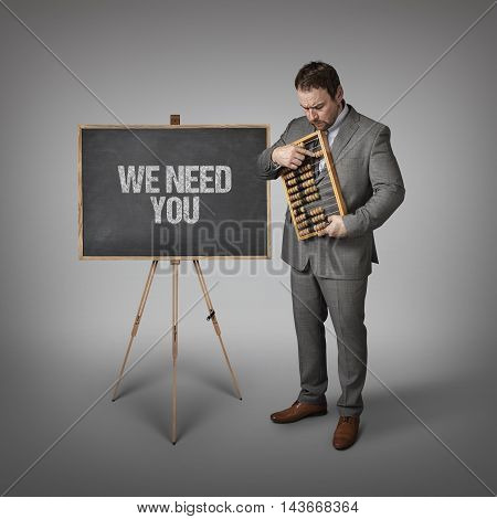 We need you text on blackboard with businessman and abacus
