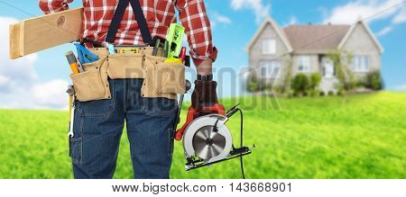 Builder handyman with electric saw.