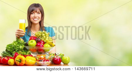 Young healthy woman with orange juice and fruits.
