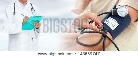 Man measuring his blood pressure.