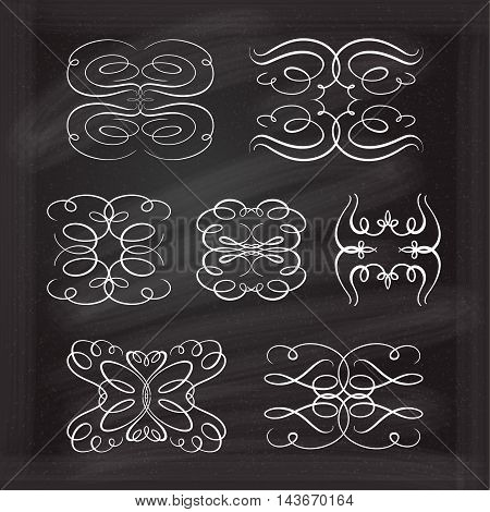 Set of elegant white flourishes for your design on the chalkboard.